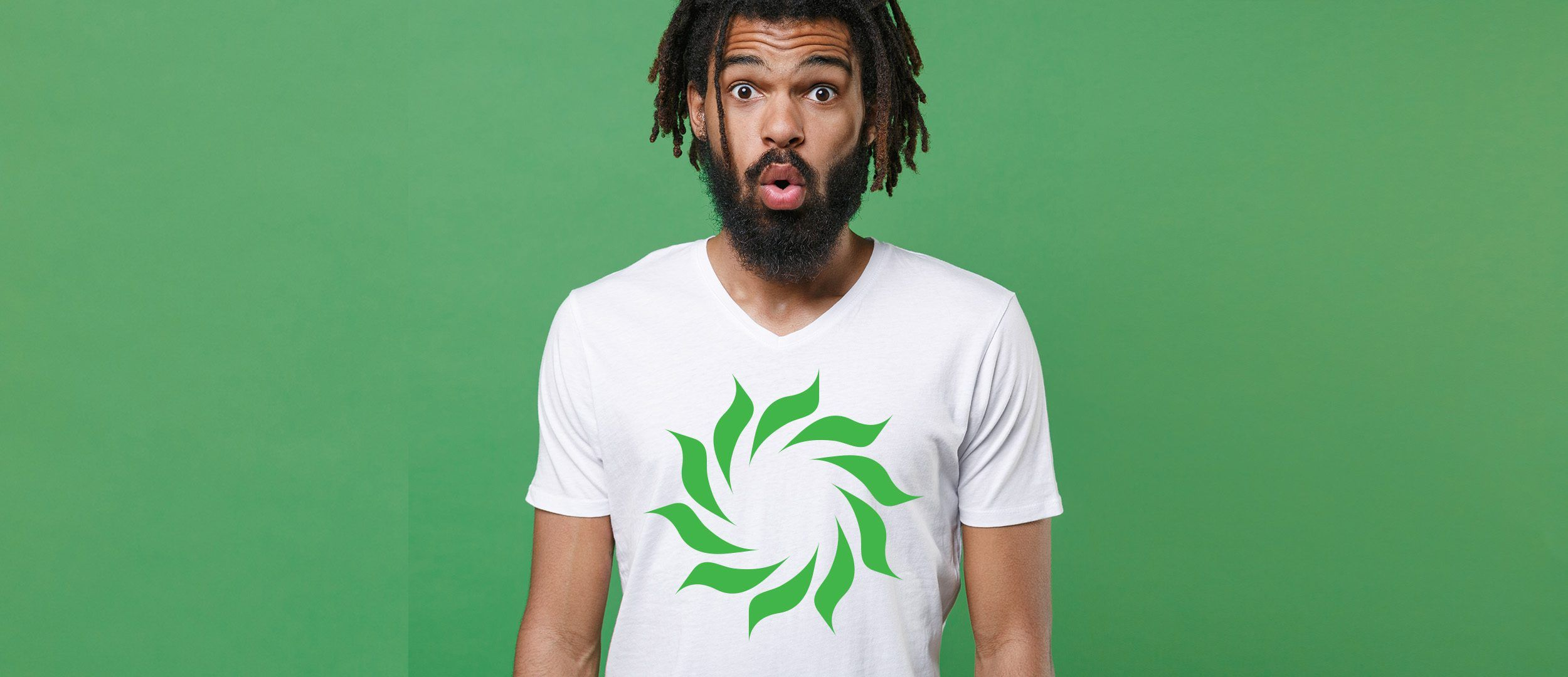 Shocked amazed young african american man guy wearing white casual t-shirt posing isolated on green wall background studio portrait. People sincere emotions lifestyle concept. Looking camera
